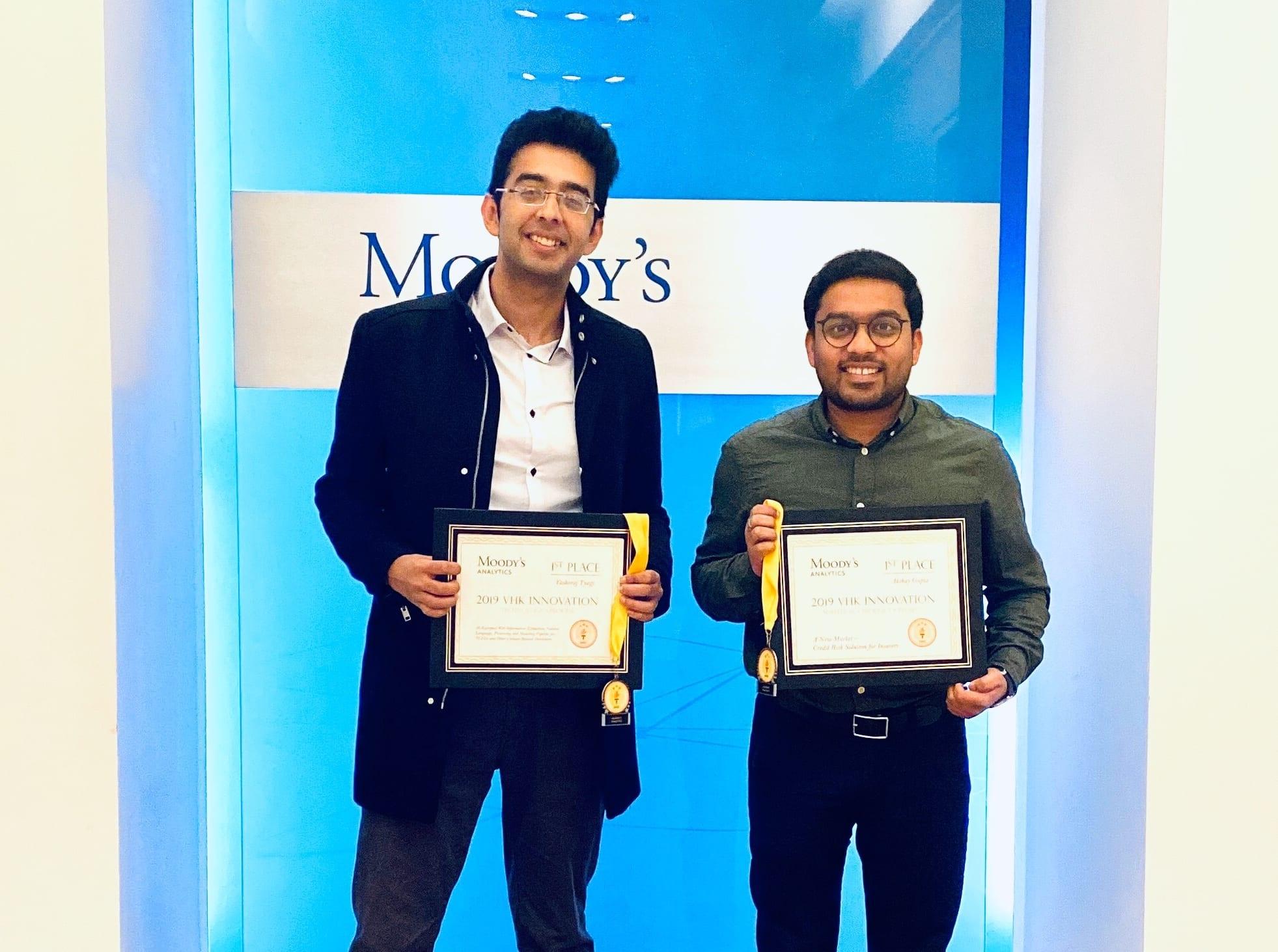 Two Berkeley MFE students holding awards